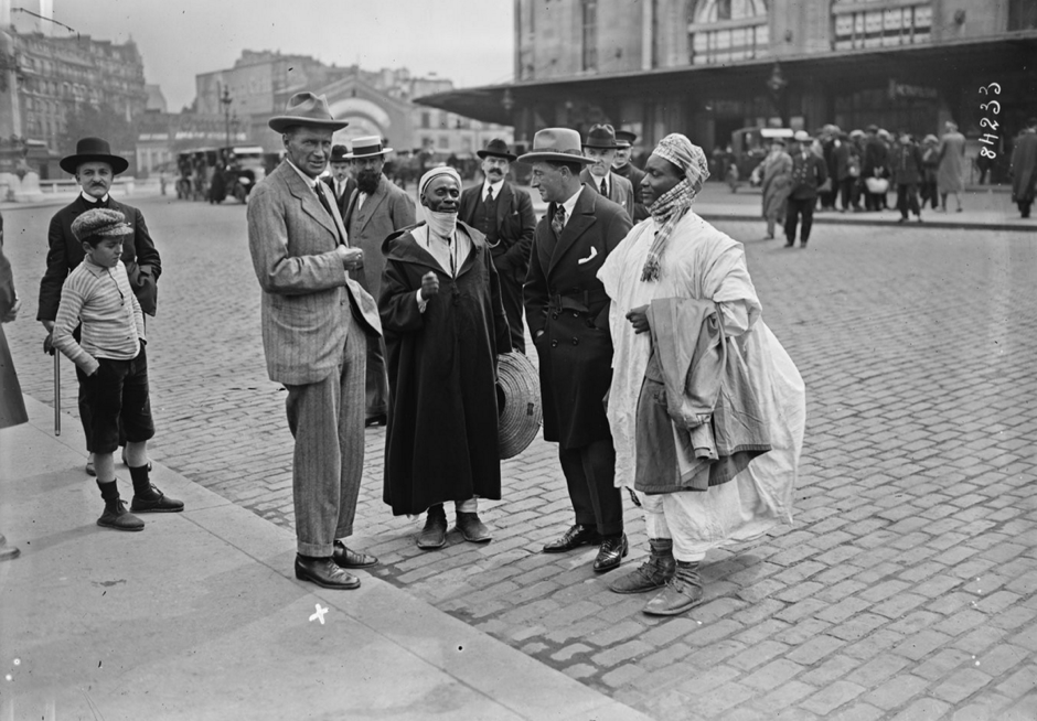 Angus is seen here after arriving at Lyon Station in Paris in June 1923. I think the man second on the right is T.A. Glover and others in the guides Ali and Sakari)