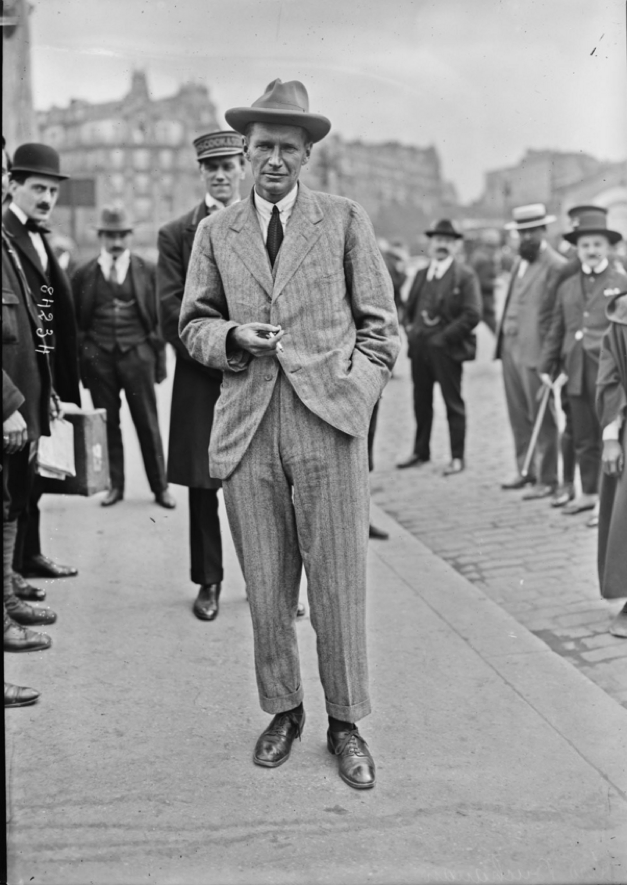 Angus is seen here after arriving at Lyon Station in Paris in June 1923. (note the Charlie Chaplin look-alike on the left!)