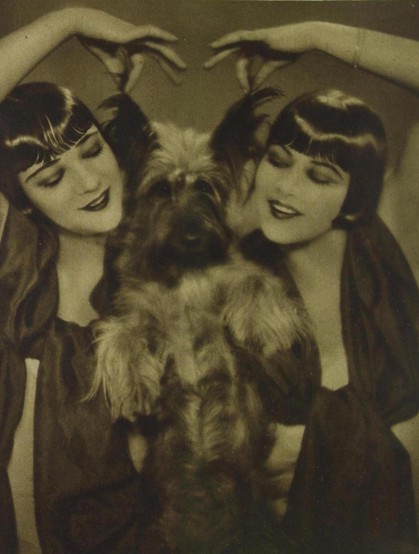 The sisters with one of their terrier dogs (either Sweetie or Goodie), photographed by Manassé, c.1928